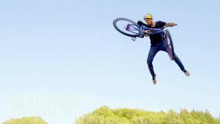 Polish mountain biker lands world's first quadruple tail whip