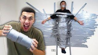 DUCT TAPE GIRLFRIEND TO WALL FOR 24 HOURS PRANK!!